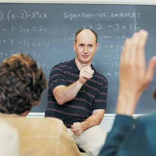 A picture of a teacher in front of a group of students.
